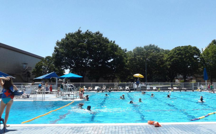 Families spend the day cooling off at the Sakana Pool at Yokota Air Base, Japan, on July 14, 2015. The Japan Meteorological Agency has posted heat advisories for much of the nation.