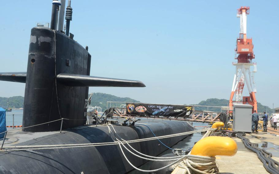 The USS Michigan is one of the Navy's four nuclear-powered Ohio-class guided-missile submarines. The Michigan, which is 560 feet long, is capable of conducting strike operations and supporting special operations missions. The submarine arrived at Yokosuka Naval Base on July 6, 2015, for a scheduled port visit.