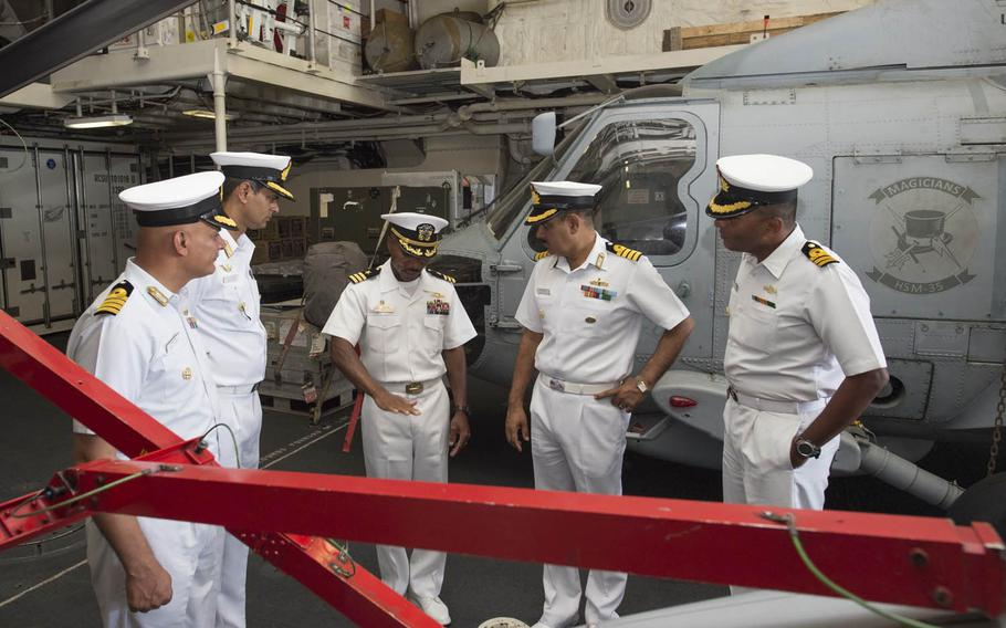 Cmdr. Christopher Brown, commanding officer of the USS Fort Worth, center, speaks with officers from the Indian navy and Japan Maritime Self-Defense Force on Wednesday, Oct. 14, 2015, as part of Exercise Malabar 2015. This year's training, which runs through Oct. 19, focuses on surface and anti-submarine warfare, air defense and search-and-rescue tactics.