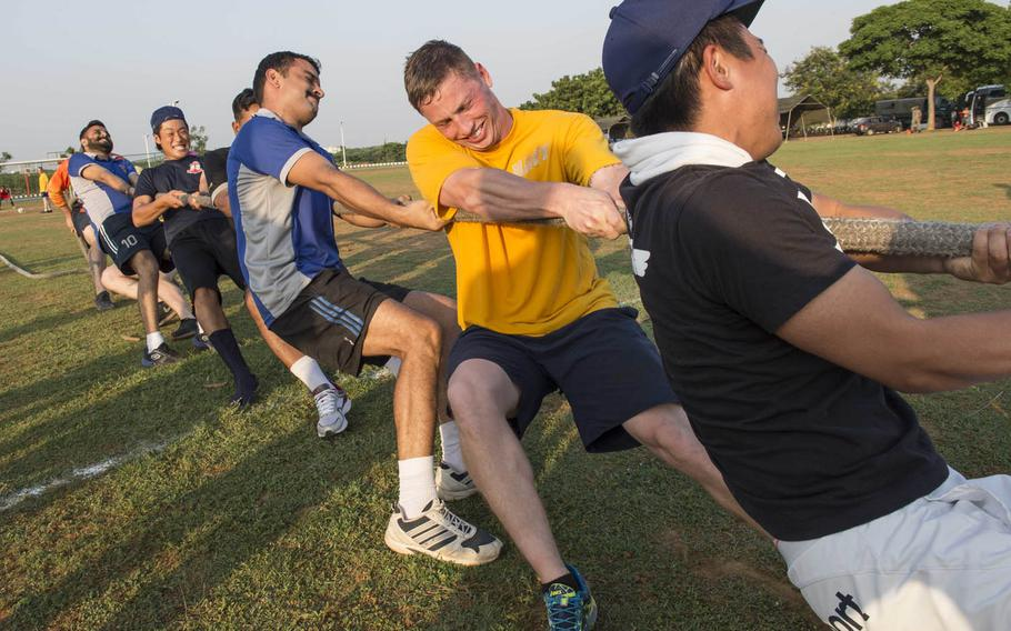 Sailors from the U.S. and Indian navies and the Japan Maritime Self-Defense Force complete in tug-of-war Wednesday, Oct. 14, 2015, during Exercise Malabar 2015. Malabar is annual sea and shore training aimed at enhancing maritime security in the Indo-Pacific region.
