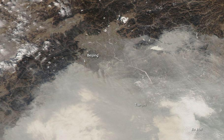 """Fog and haze blanket the North China Plain on Jan. 10, 2012. The effects of climate change on China will present a """"major security challenge"""" this century for the United States and Asia, according to a Center for Climate and Security study released Tuesday, Nov. 17, 2015."""