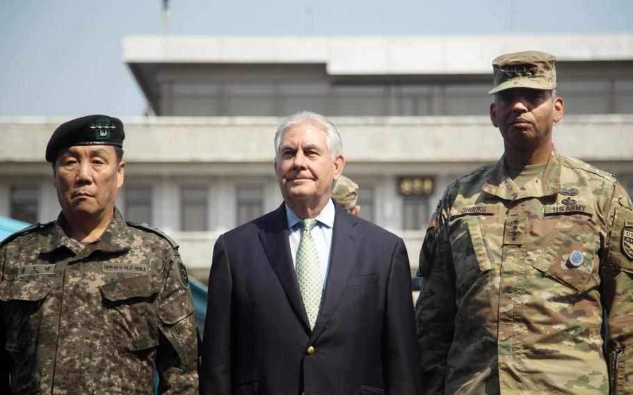 Secretary of State Rex Tillerson, center, poses with Gen. Vincent Brooks, right, U.S. Forces Korea commander, and South Korean Gen. Leem Ho Young at the Joint Security Area of the Demilitarized Zone, Friday, March 17, 2017.