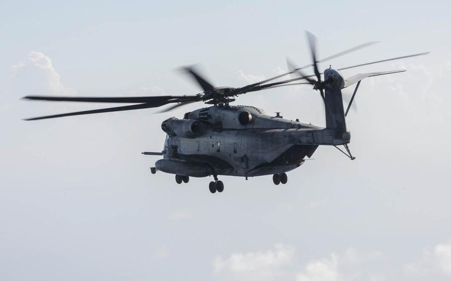 A CH-53E Super Stallion from Marine Heavy Helicopter Squadron 462, 3rd Marine Aircraft Wing flies off the coast of Okinawa, Japan, July 31, 2017.