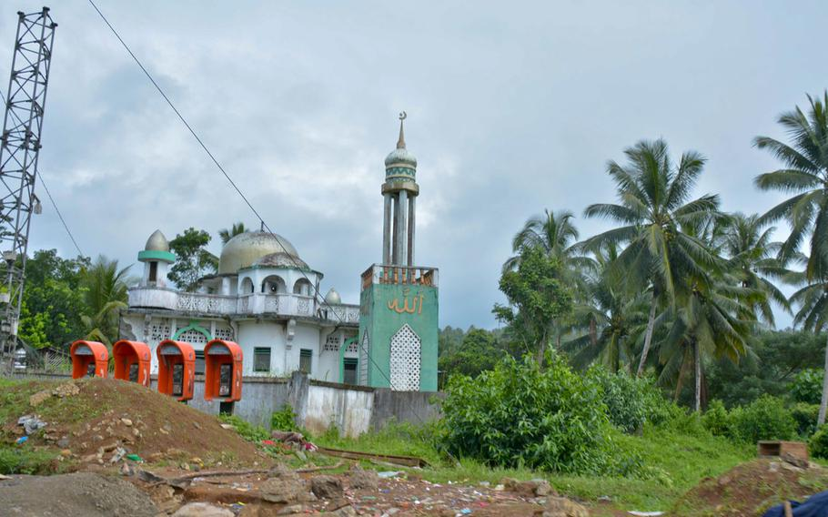A mosque on the road to Marawi, Philippines, where the Filipino soldiers fought a bloody battle against Islamic State insurgents this summer.