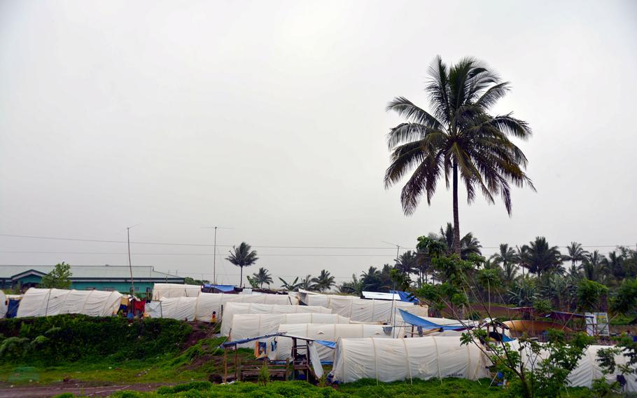 A camp for displaced Muslims whose homes were destroyed during the battle to liberate Marawi stands just outside the Philippine city, Wednesday, Nov. 8, 2017.