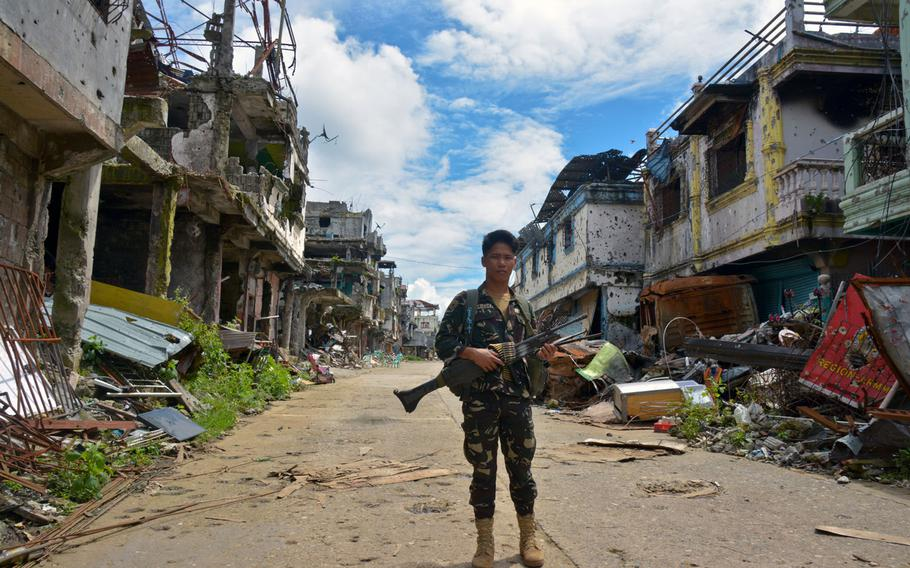 A Filipino soldier stands in the Marawi battle zone, Wednesday, Nov. 8, 2017.