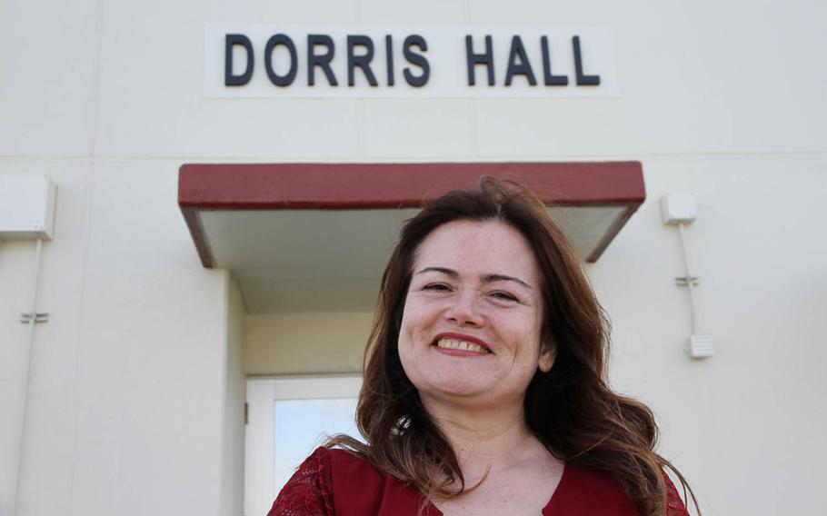 Chikako McMaster poses outside Dorris Hall at Camp Courtney, Okinawa, Friday, Dec. 22, 2017. The barracks were named for her father, Navy Cross recipient Marine Staff Sgt. Claude Dorris.