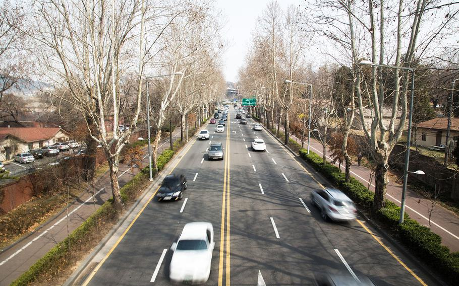 Cars zoom down a road bisecting Yongsan Garrison in Seoul, South Korea, Thursday, March, 30, 2017.