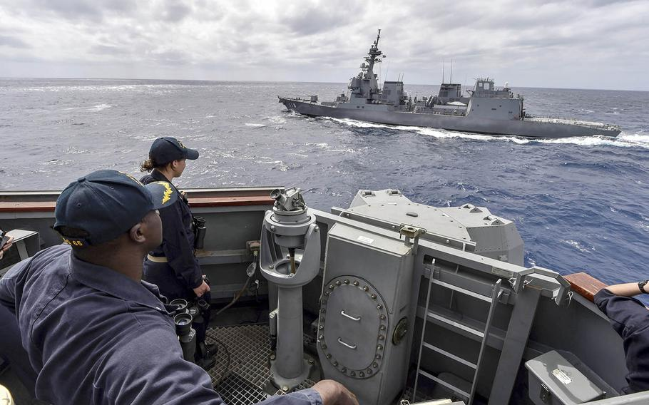 The guided-missile destroyer USS Benfold, foreground, sails alongside the Japanese destroyer JS Fuyuzuki during a close-quarters maneuvering drill last month in the Philippine Sea. Both ships are taking part in MultiSail 2018, which is underway near Guam.