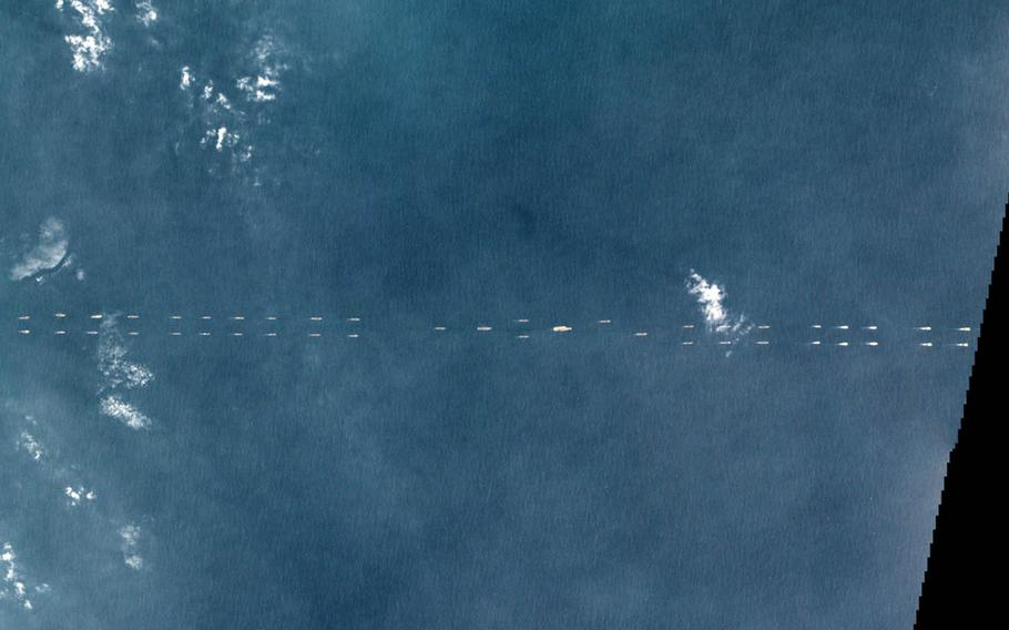 This satellite image taken Monday, March 26, 2018, shows a formation of Chinese ships off the coast of Hainan Province, China.