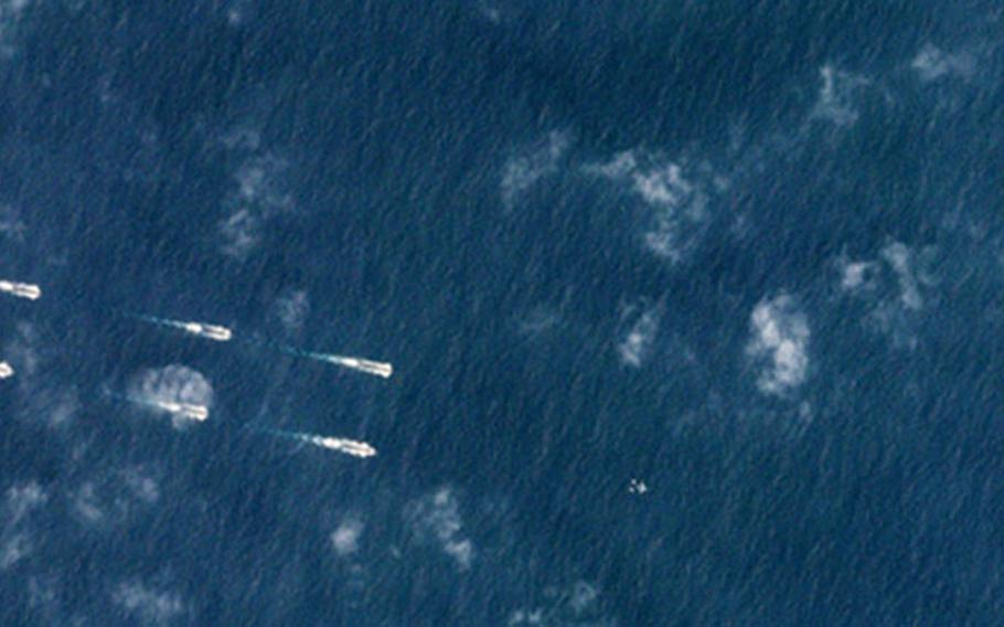 This satellite image taken Monday, March 26, 2018, shows Chinese ships off the coast of Hainan Province, China, during annual spring drills.