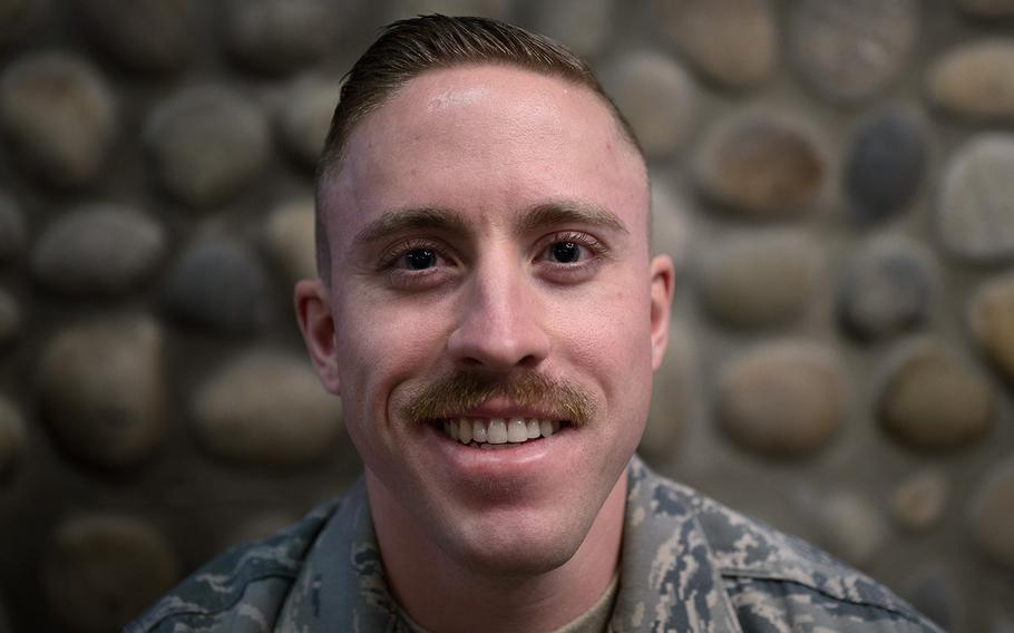 Senior Airman Adam Clapp of the 8th Operations Support Squadron, 8th Fighter Wing displays his mustache at Kunsan Air Base, South Korea, Tuesday, March 27, 2018.