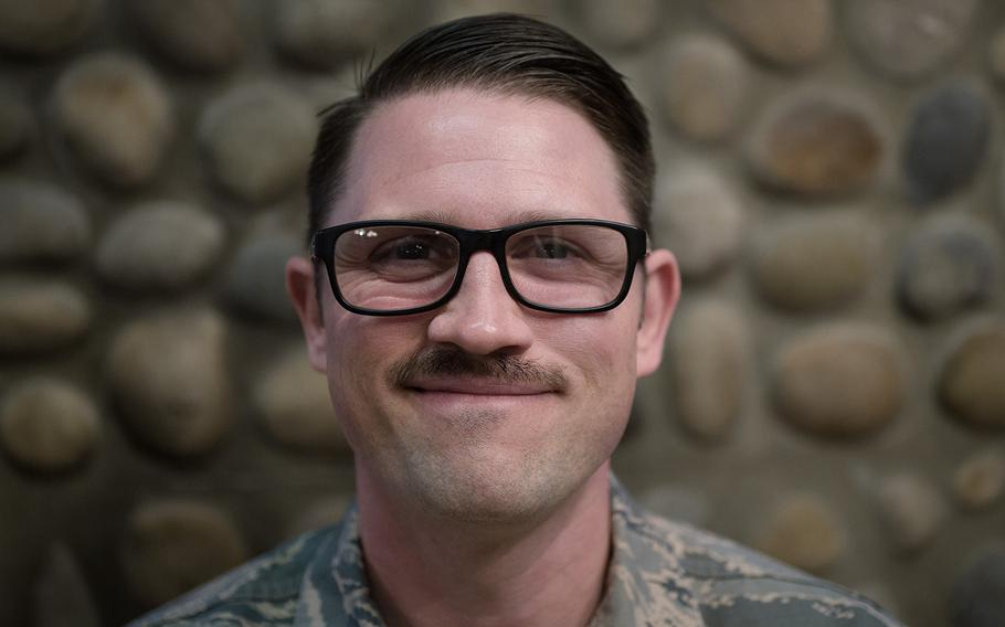 Maj. John Jarzabek of the 8th Communications Squadron, 8th Fighter Wing displays his mustache at Kunsan Air Base, South Korea, Tuesday, March 27, 2018.