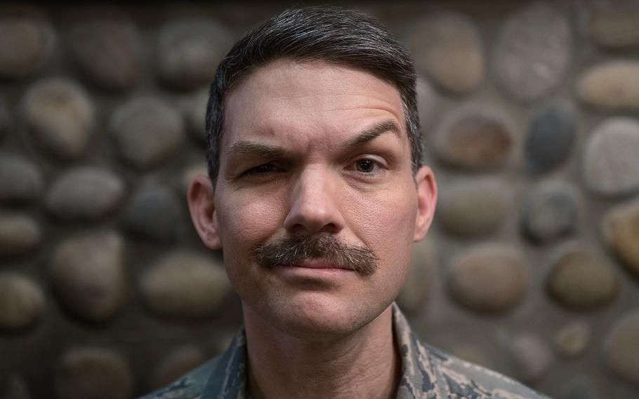 Lt. Col. John Roberts of the 8th Mission Support Group, 8th Fighter Wing displays his mustache at Kunsan Air Base, South Korea, Tuesday, March 27, 2018.