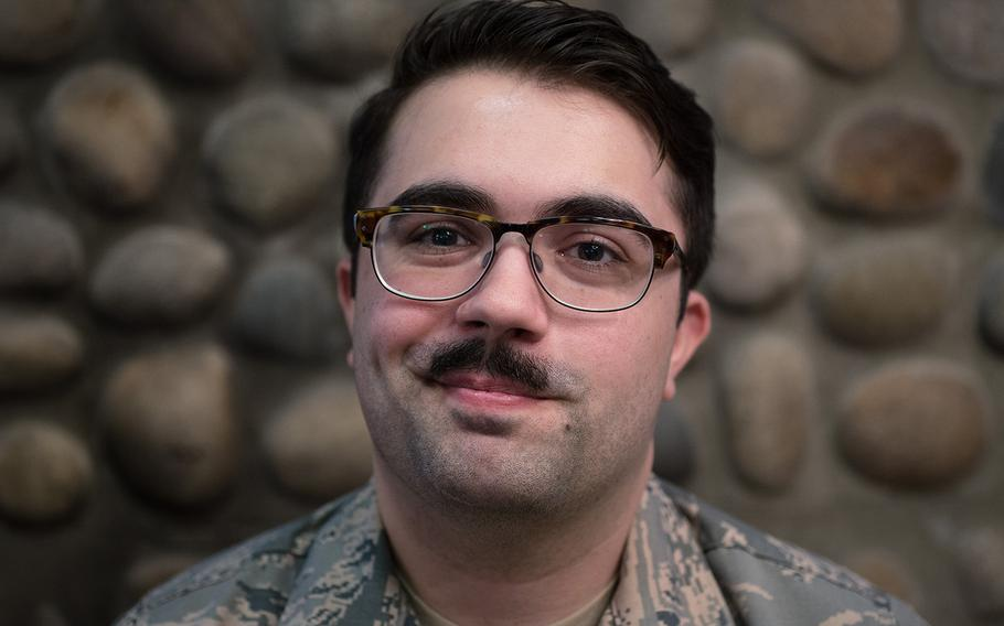 Senior Airman Steffan Sullivan of the 8th Operations Support Squadron, 8th Fighter Wing shows off his mustache at Kunsan Air Base, South Korea, Tuesday, March 27, 2018.