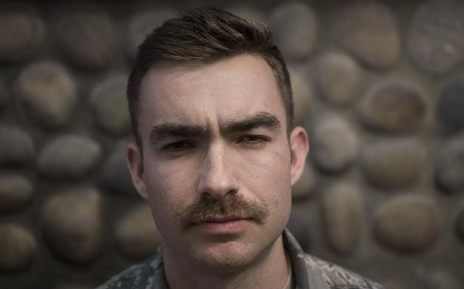 1st Lt. Chad Miles of the 8th Force Support Squadron, 8th Fighter Wing shows off his mustache at Kunsan Air Base, South Korea, Tuesday, March 27, 2018.