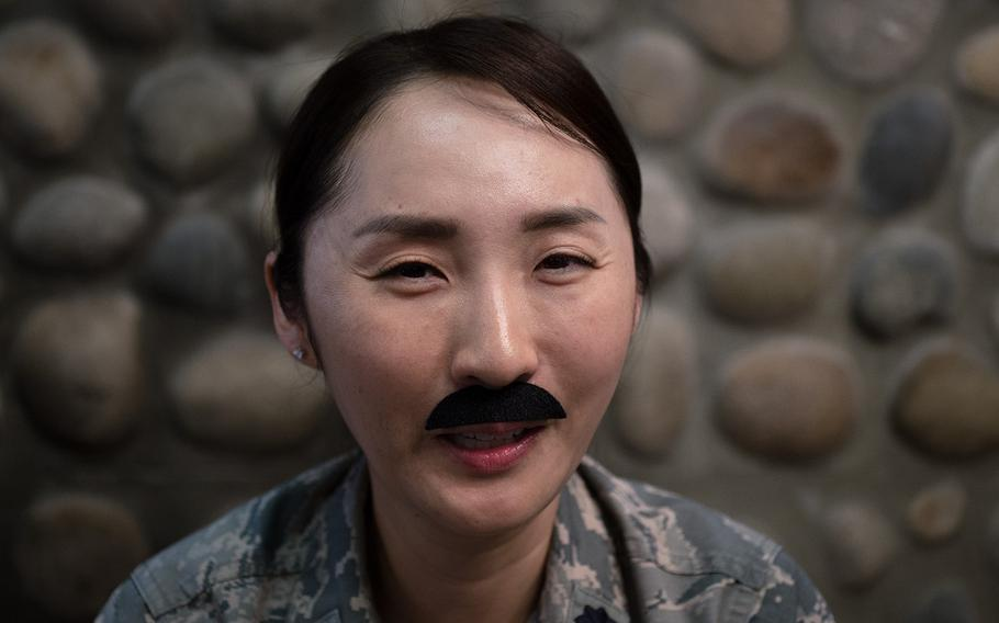 Lt. Col. Sila Pang of the 8th Force Support Squadron, 8th Fighter Wing shows off her mustache at Kunsan Air Base, South Korea, Tuesday, March 27, 2018.