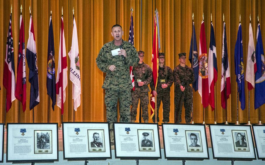 Marine Col. Kevin Norton, 4th Marine Regiment commander, speaks about the unit's history while standing behind photos of its numerous Medal of Honor recipients at Camp Schwab, Okinawa, March 9, 2017.
