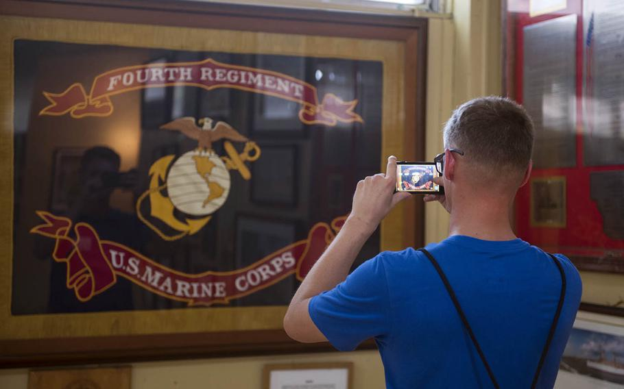 A Marine with the Okinawa-based 4th Marine Regiment takes a photo of the unit colors at the Pacific War Memorial Museum at Corregidor, Philippines, May 5, 2017.