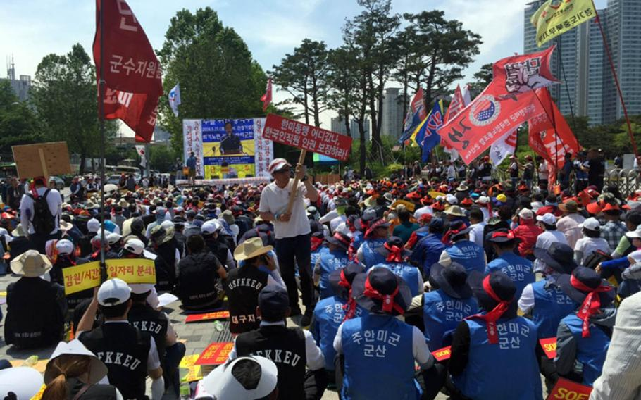 South Korean civilian employees working on U.S. bases rally near U.S. Army Garrison Yongsan in Seoul in 2016 amid fears about job losses and benefits as most American forces prepare to relocate to regional hubs south of Seoul.