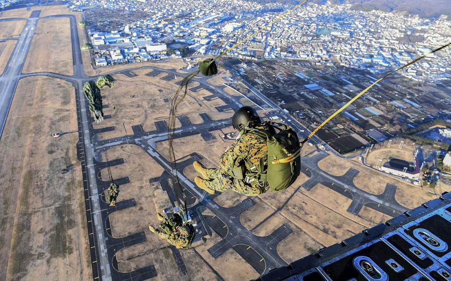 Marines with the 3rd Reconnaissance Battalion, 3rd Marine Division, III Marine Expeditionary Force, perform a static line parachute jump last year at Yokota Air Base, Japan.