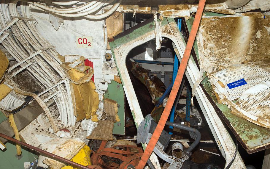 Damage is seen inside the guided-missile destroyer USS Fitzgerald as it sits in dry dock at Yokosuka Naval Base, Japan, soon after its June 17, 2017, collision with a merchant vessel.
