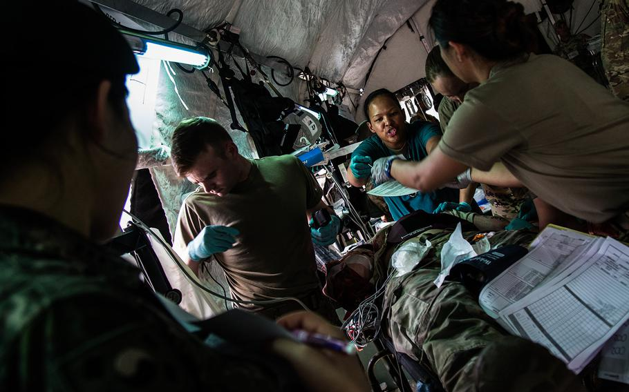 Emergency room doctors and medics work on a patient during a mass casualty scenario at the 121st Combat Support Hospital at Camp Humphreys, South Korea, Friday, April 20, 2018.