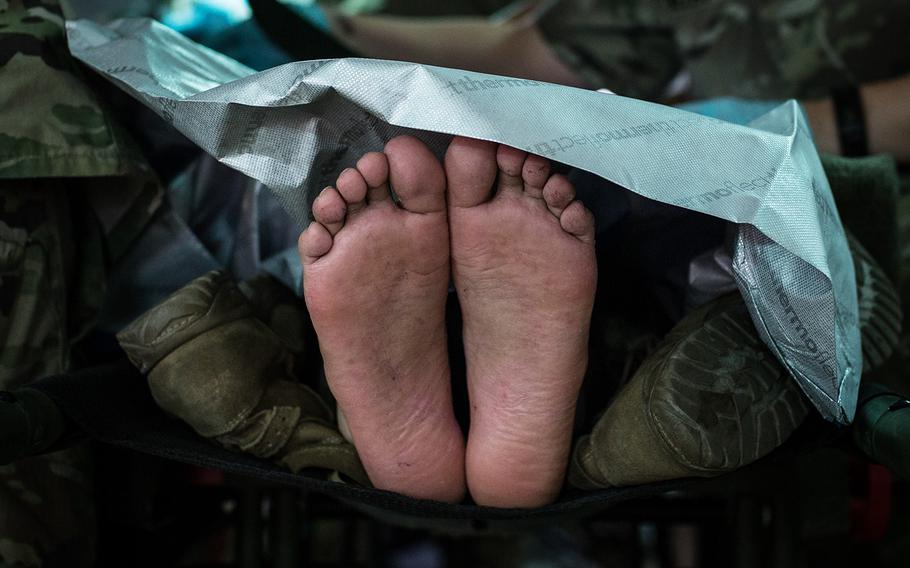 A patient's feet during a mass casualty scenario at the 121st Combat Support Hospital on Camp Humphreys, South Korea, Friday, April 20, 2018.