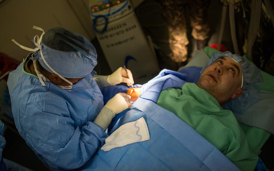 A live surgery is performed during a mass casualty scenario at the 121st Combat Support Hospital on Camp Humphreys, South Korea, Friday, April 20, 2018.