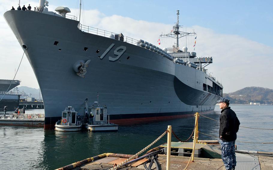 Capt. Jeffrey Kim, commander of Yokosuka Naval Base, Japan, stands near the USS Blue Ridge earlier this year.