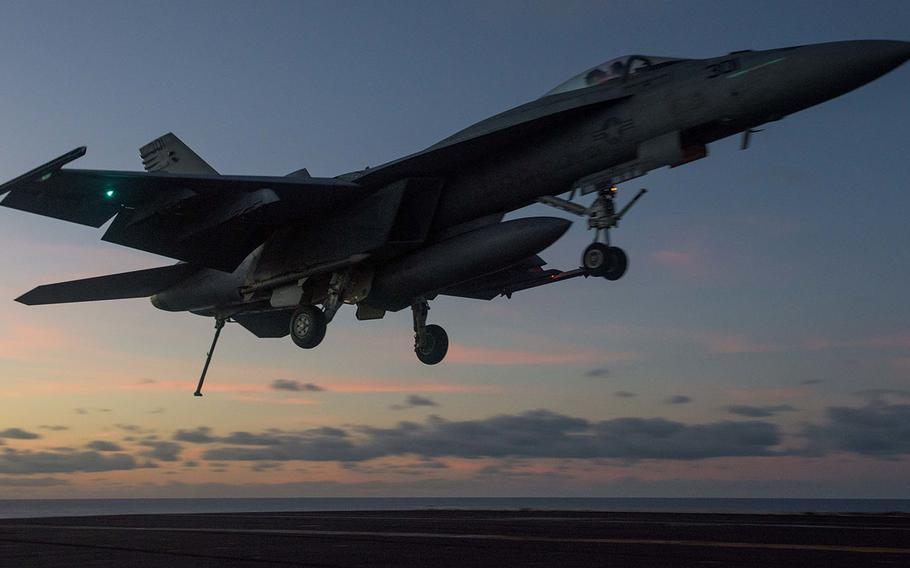 An F/A-18E Super Hornet from Strike Fighter Squadron 115 prepares to land last year aboard the USS Ronald Reagan in the Coral Sea.
