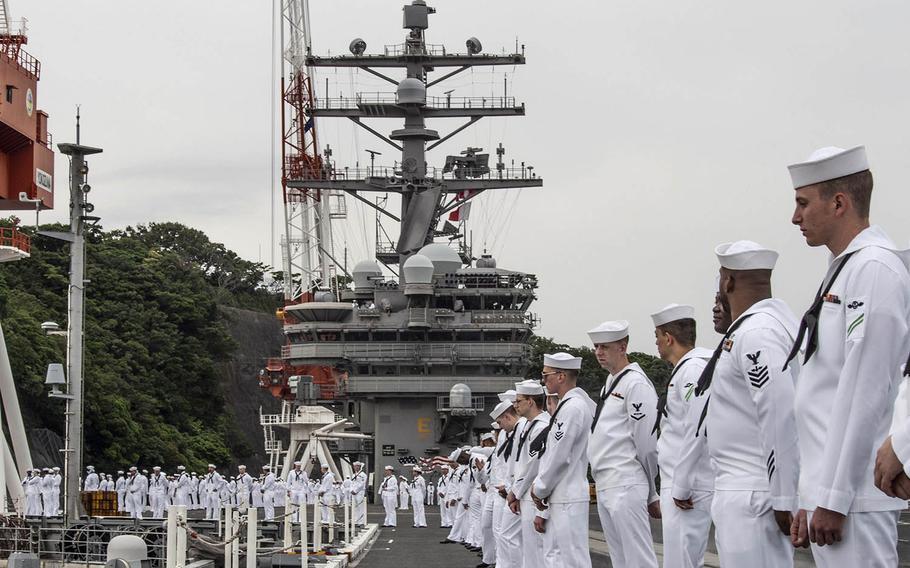 Sailors man the rails as the aircraft carrier USS Ronald Reagan departs Yokosuka Naval Base, Japan, Tuesday, May 29, 2018.