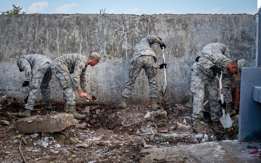 U.S. Air Force engineers with the 18th Civil Engineer Squadron from Kadena Air Base, Japan, correct the slope of a drainage pipe at the Negri Saran Kote Secondary School during Pacific Angel 2018 in Suai, Cova Lima Municipality, Southwest Timor-Leste, June 9, 2018.