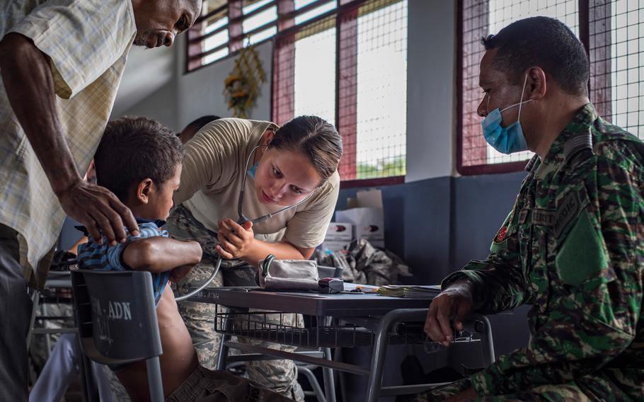 U.S. Air Force Senior Airman Hannah Zink, right, a 15th Aerospace Medicine Squadron aerospace medical technician from Joint Base Pearl Harbor-Hickam, Hawaii, checks his vitals at the Negri Saran Kote Secondary School during Pacific Angel 2018 in Suai, Cova Lima Municipality, Southwest Timor-Leste, June 11, 2018.