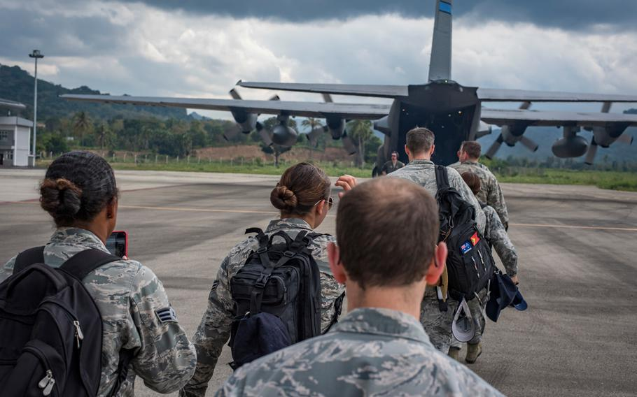 U.S. military personnel board a 910th Air Wing C-130H Hercules from Youngstown, Ohio, to begin their journey back to their home stations following the closing ceremonies for Pacific Angel 2018 at the Suai Airport in Suai, Cova Lima Municipality, Southwest Timor-Leste, June 18, 2018.
