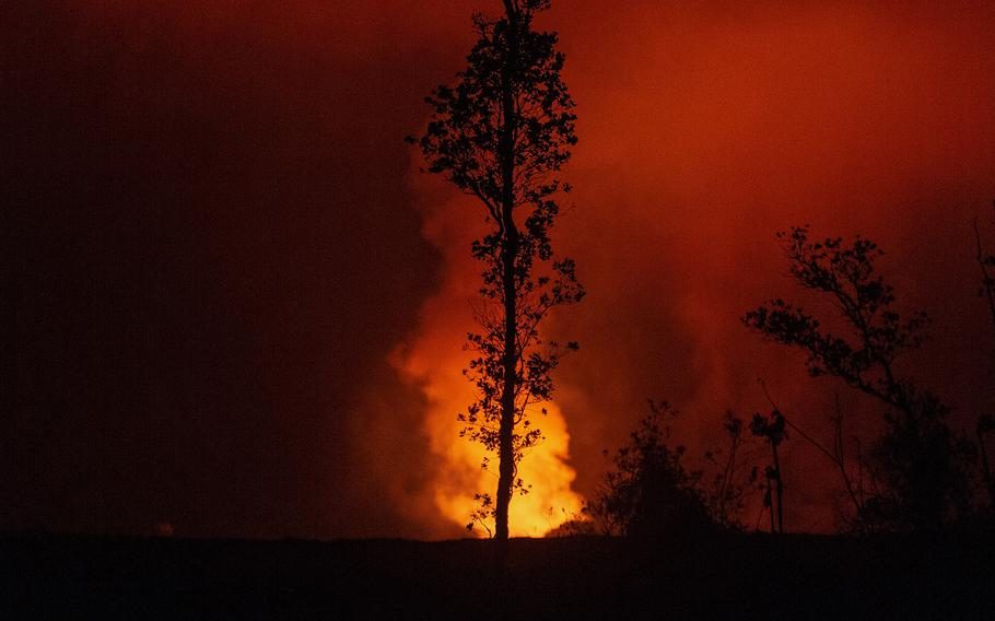 A fissure from the Kilauea volcano is seen from Leilani Estates, Hawaii, Tuesday, July 17, 2018.