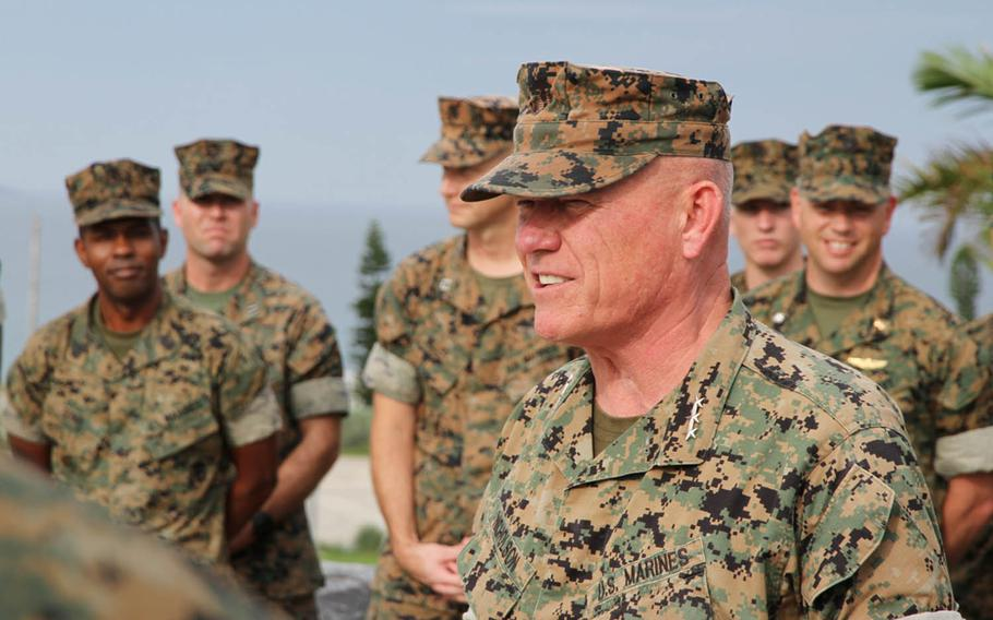 In his last official act as III Marine Expeditionary Force commander, Lt. Gen. Lawrence Nicholson meritoriously promoted five Marines and a Navy corpsman at Camp Courtney, Okinawa, Thursday, Aug. 2, 2018.