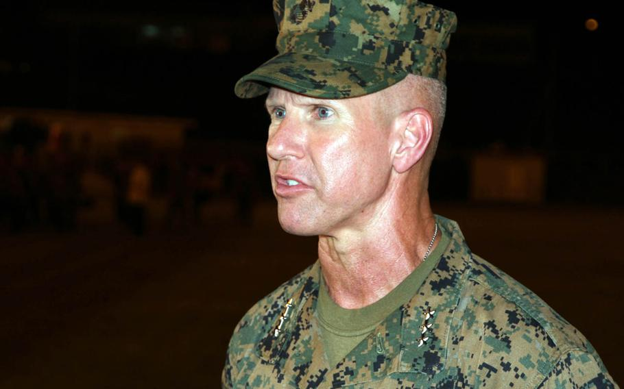Lt. Gen. Eric Smith speaks to reporters after taking command of the III Marine Expeditionary Force at Camp Courtney, Okinawa, Thursday, Aug. 2, 2018.