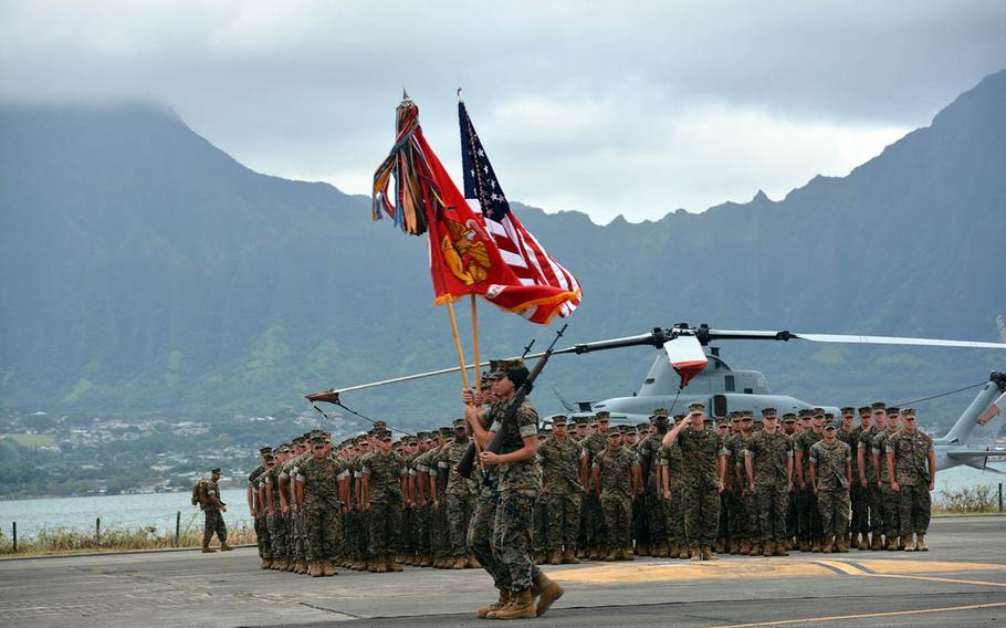 Marines stand at attention with the passing of the color guard during a ceremony marking change of command of Marine Corps Forces Pacific at Marine Corps Base Hawaii, Wednesday, Aug. 8, 2018.