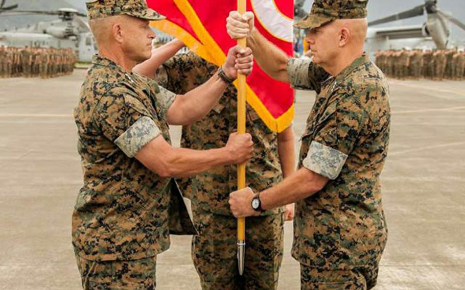Lt. Gen. David Berger, right, outgoing commander of Marine Corps Forces Pacific, passes the colors to incoming commander Lt. Gen. Lewis Craparotta at Marine Corps Base Hawaii, Wednesday, Aug. 8, 2018.