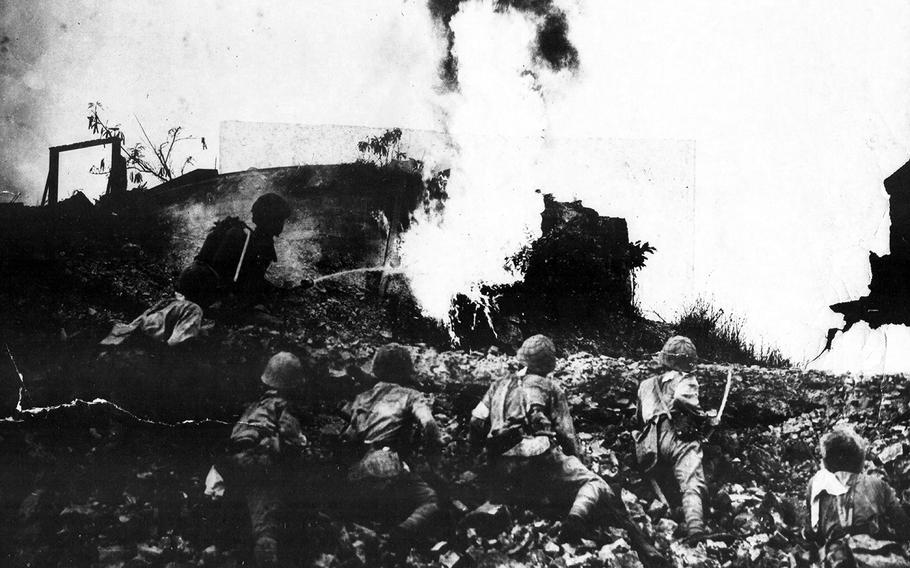 Japanese flame throwers attack one of the last American outposts on Corregidor Island, Philippines, in the spring of 1942.