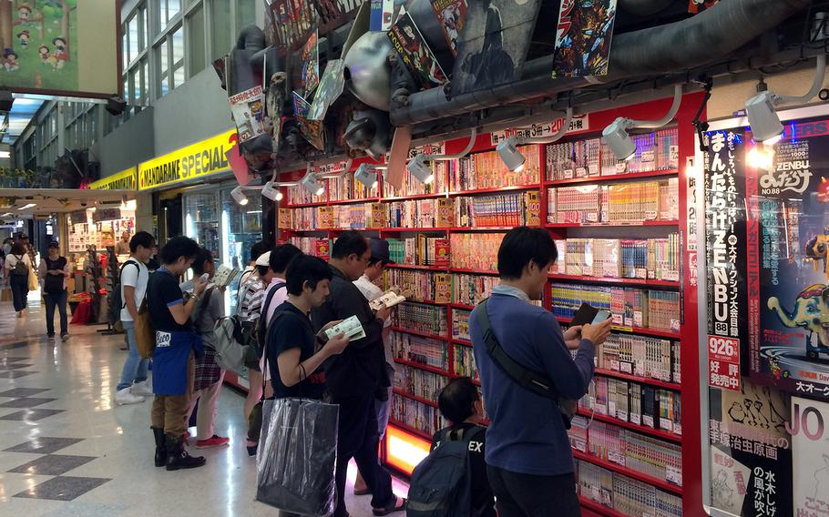 Shoppers at Nakano Broadway in Tokyo peruse the many manga comics at a Mandrake chain store. The shopping center is a four-story treasure trove of individual shops selling goods featuring some of Japan's most famous anime and manga franchises — and some obscure ones, too.