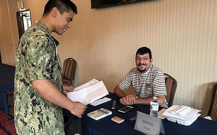 Servicemembers looking at post-military career options attend a job fair at Yokosuka Naval Base, Japan, Wednesday, Aug. 29, 2018.