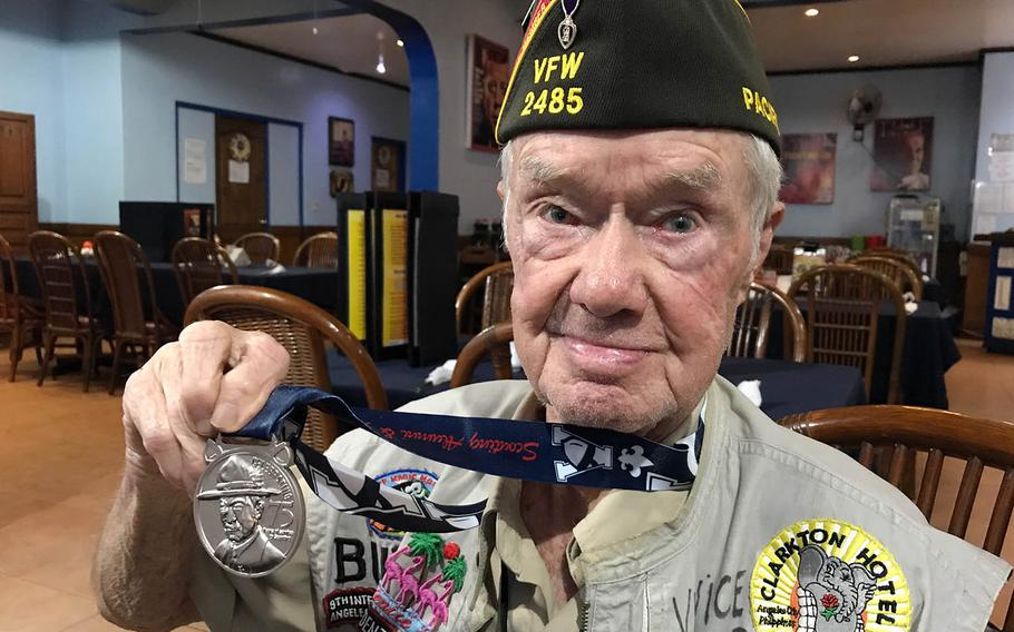 """Willis """"Buddy"""" Clark Jr. shows off the medal he received for 75 years of service to the Boy Scouts in Angeles City, Philippines, Saturday, Sept. 22, 2018."""