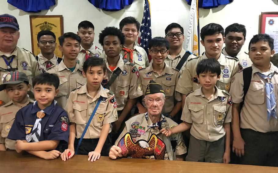 """Willis """"Buddy"""" Clark Jr., 87, poses with members of Boy Scout Troop 485 in Angeles City, Philippines, Saturday, Sept. 22, 2018."""