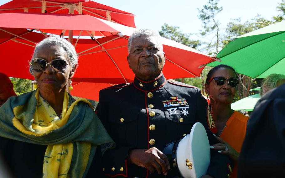 Theodore Bush Hudson Jr., center, a Korean War veteran who participated in the Marine landing at Incheon and the Chosin Reservoir campaign, stands with his wife and daughter during a ceremony honoring adoptees in Paju, South Korea, Sept. 12, 2018.