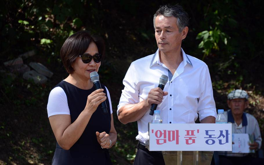 Sculptor Kim Won-sook and her husband, Thomas Park Clement, a South Korean adoptee who now lives in the United States and has financed efforts to use DNA tests to find birth parents, speak at a ceremony in Paju, South Korea, Sept. 12, 2018.