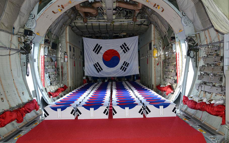 Draped in South Korean flags, 63 boxes of remains fill the hold of a C-130 cargo plane ahead of a repatriation ceremony at Joint Base Pearl Harbor-Hickam, Hawaii, Thursday, Sept. 27, 2018.
