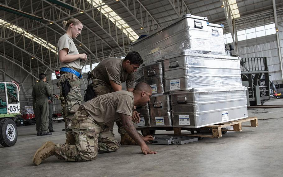 Airmen assigned to the 36th Contingency Response Group at Andersen Air Force Base, Guam, prepare and inspect disaster-relief supplies in Balikpapan, Indonesia, Oct. 5, 2018.