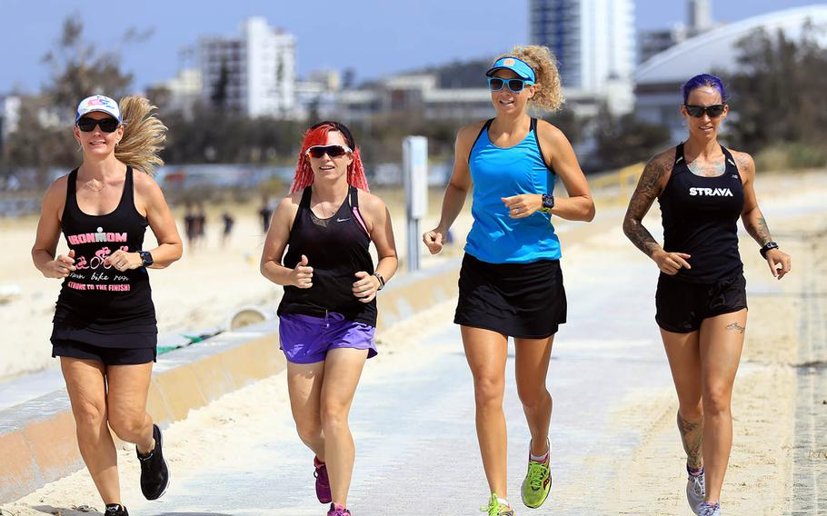 Marine Corps spouse Alyx Ulbrich, far right, trains with friends for the upcoming Decaman USA race Nov. 6, 2018, in New Orleans.